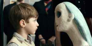 Never Look Away film still of the younger artist Kurt Schilling staring at a sculpture in a german gallery