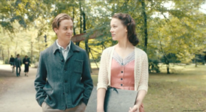 Never Look Away film still of Kurt Barnert (Edward Schilling) and Ellie Seeband (Paula Beer) on there first date walking in the park